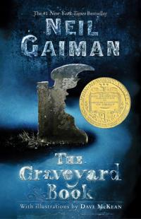The Graveyard Book book cover (an old grave with a cutout part in the shape of a young boy's face, with shadowy fog in the background)